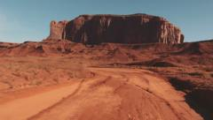 Driving USA: Point of view car along dirt road in Monument Valley, Arizona Utah Stock Footage