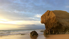 Beautiful ocean with sunset and rock formations - stock footage