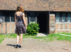 Young woman outside country house - stock photo