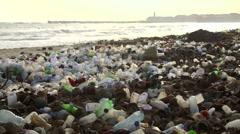 Beach in accra, ghana, polluted with bottles Arkistovideo