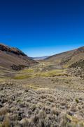 Landscape of an arid valley in the Andean highlands - stock photo