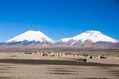 Parinacota and Pomerade volcanos. High Andean landscape in the Andes. Bolivia - stock photo
