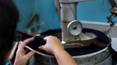 Woman working on a textile factory Stock Footage