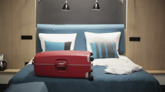 Woman traveller unpacking suitcase in hotel room Stock Footage