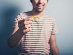 Happy man with ticket Stock Photos