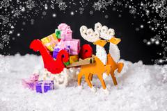 Beautiful composition of Christmas decoration reindeer and Santa sleigh with  Kuvituskuvat