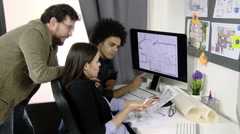 Three architects discussing project of home in front of computer getting angr Stock Footage