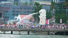 Crowd near Merlion statue a popular tourist Singaporean landmark Stock Footage