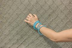 Hand of woman grabbing fence - stock photo
