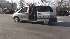 City police car, fast intervention, beacon, military men parade, demonstration - stock footage