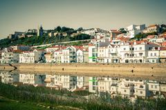 View of city Alcacer do Sal near the river Sado in Portugal - stock photo