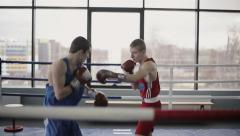 Young boxers have a fight at ring in a boxing club Stock Footage