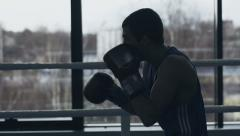 Silhouette of a young boxer Stock Footage