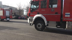 Stock Video Footage of Firefighters cars, firemen parade, huge car filled with water, heroes, rescuers