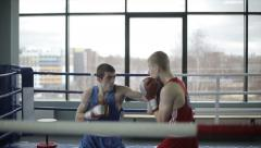 Young boxers have a fight at ring in a boxing club. Slow motion - stock footage