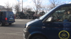 Armed men in police cars at military parade, closeup view, police intervention - stock footage