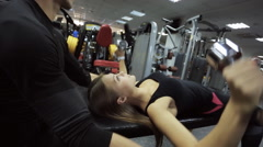 Stock Video Footage of coach male athlete holds the elbows of young attractive woman in the gym and