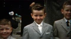 1955: Young brothers dressed in gray pinstripe fashion suits view by elders. Stock Footage