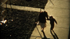 1955: Storytelling of mom teaching child to rollerskate one step at a time and - stock footage