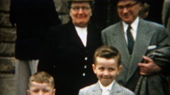 1955: Adults marveling at young boys sharply dressed for formal event. - stock footage