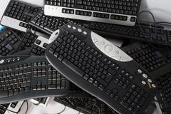 Stock Photo of Old, used and obsolete electronic keyboards