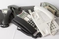 Stack Pile of Several old and modern Phones Isolated - stock photo