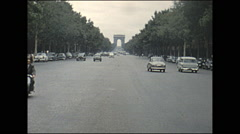 Vintage 16mm film, 1955, France Paris, traffic, standing on a traffic island Stock Footage