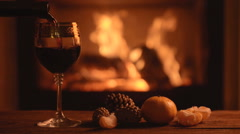 Pouring delicious red wine at romantic fireplace Stock Footage