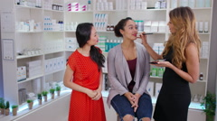4K TV presenters on shopping channel selling beauty products & talking to camera Stock Footage