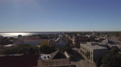 Aerial Shot Rising to Reveal Downtown Charleston, SC and Cooper River in the dis Arkistovideo