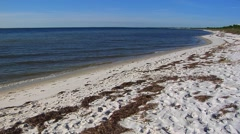 WS white sandy beach curves left along Gulf of, Florida Stock Footage