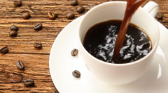 A cup of coffee milk and coffee beans. Stock Footage