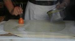 A woman prepares a pie Stock Footage