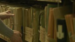 Man looking documents in the archive. Stock Footage