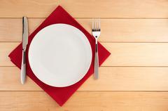 Kitchen utensils at cloth napkin on wood Stock Photos
