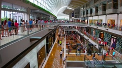 Customer flow inside of big shopping mall The Shoppes at Marina Bay Sands Stock Footage