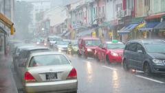 Shower rain in urban city area with car standing it traffic jam Stock Footage