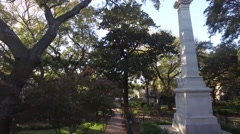 Stock Video Footage of Aerial Shot Ascending Length of Statue in a Town Square Park in Savannah, GA