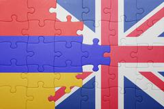 puzzle with the national flag of great britain and armenia - stock photo