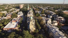 Aerial of Rows of Houses and Two Churches in Historic District of Savannah, GA Stock Footage