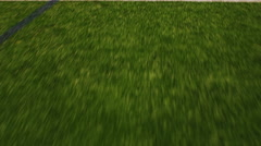 Pan over the lines on a football field, close up Stock Footage