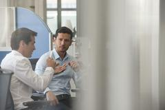 Colleagues discussing innovative solution to everyday problem - stock photo