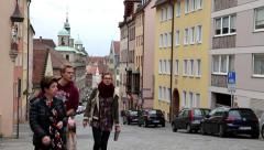 Tourists walking on the Burg Strasse for visiting the Nuremberg Castle Stock Footage