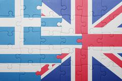 puzzle with the national flag of great britain and greece - stock photo