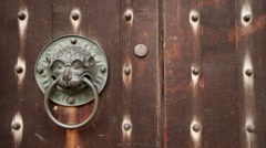 Vintage wood door with retro hand knock lion shape used as buzzer ringer knocker Stock Footage