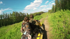 Two Man on ATV in forest video Selfe Stock Footage