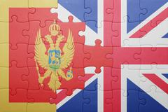 Puzzle with the national flag of great britain and montenegro Stock Photos