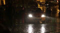 A taxi cab waiting in the heavy rain for clients to arrive. - stock footage