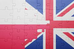 Puzzle with the national flag of great britain and poland Stock Photos