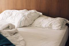 Unmade bed - stock photo